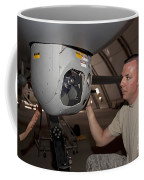 A Crew Chief Works On Mq-1 Predators Coffee Mug by HIGH-G Productions