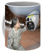 A Crew Chief Works On Mq-9 Reapers Coffee Mug by HIGH-G Productions