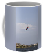 A Kiteboarder Jumps High Over Beach Coffee Mug by Skip Brown