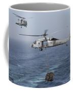 A Mh-60s Knighthawk Transfers Cargo Coffee Mug by Gert Kromhout