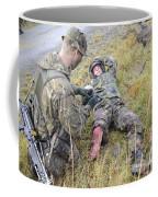 A Patrol Medic Applies First Aid Coffee Mug by Andrew Chittock