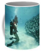 A School Of Grunts Swims By A Diver Coffee Mug by Nick Caloyianis