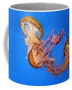 A Trio Of Jellyfish Coffee Mug by Kristin Elmquist