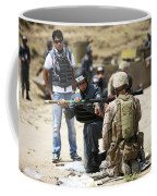 An Afghan Police Student Loads A Rpg-7 Coffee Mug by Terry Moore