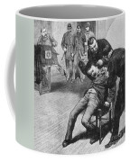 Anarchist Being Held Down For Mug Shot Coffee Mug by Photo Researchers