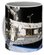 Astronauts Continue Maintenance Coffee Mug by Stocktrek Images