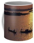 Boats Silhouetted On The Mekong River Coffee Mug by Steve Raymer