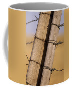 Gate Posts Join A Barbed Wire Fence Coffee Mug by Gordon Wiltsie
