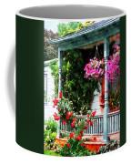 Hanging Baskets And Climbing Roses Coffee Mug by Susan Savad