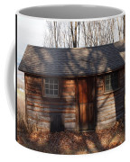 Little Cabin In The Woods Coffee Mug by Robert Margetts