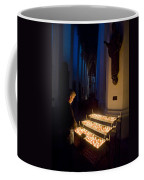 Man Prays By Candles At Frauenkirche Coffee Mug by Greg Dale