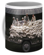 Men Sit On Bags Of Flour Coffee Mug by Justin Guariglia