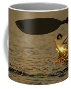Paddling A Kayak Over Walden Pond Coffee Mug by Tim Laman