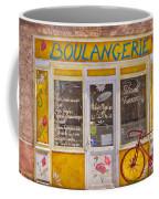 Red Bike At The Boulangerie Coffee Mug by Debra and Dave Vanderlaan