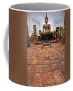 Sitting Buddha Coffee Mug by Adrian Evans