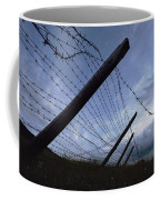 The Remains Of A Barbed Wire Fence That Coffee Mug by Steve Raymer