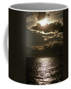 The Setting Sun Pierces A Menacing Coffee Mug by Jason Edwards