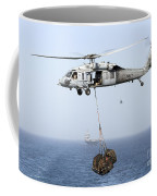 A Mh-60 Helicopter Transfers Cargo Coffee Mug by Gert Kromhout