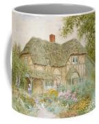 A Surrey Cottage Coffee Mug by Arthur Claude Strachan