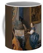 A Young Lady Seated At A Virginal Coffee Mug by Jan Vermeer