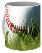Baseball In Grass Coffee Mug by Chris Brannen