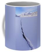 Breaking Ice Coffee Mug by Chad Dutson