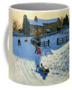 Children Sledging Coffee Mug by Andrew Macara