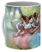 Four Ballerinas On The Stage Coffee Mug by Edgar Degas