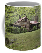 Horse Grazing In The Yard Of A Mountain Coffee Mug by Greg Dale