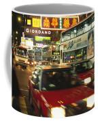 Kowloon Street Scene At Night With Neon Coffee Mug by Justin Guariglia