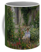 Mother And Child In The Flowers Coffee Mug by Camille Pissarro