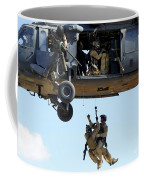 Pararescuemen Are Hoisted Into An Hh-60 Coffee Mug by Stocktrek Images