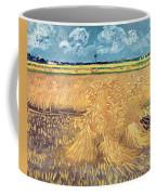 Wheatfield With Sheaves Coffee Mug by Vincent van Gogh
