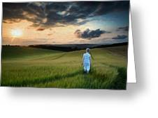 Concept landscape young boy walking through field at sunset in S Greeting Card by Matthew Gibson