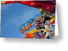 Colorful Fairground Ride Greeting Card by Ken Biggs