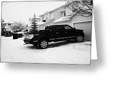 4x4 Pickup Trucks Parked In Driveway In Snow Covered Residential Street During Winter Saskatoon Sask Greeting Card by Joe Fox