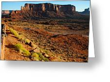 A Couple Enjoys Sunrise At The Monument Valley Tribal Park Hotel Overlook In Utah Greeting Card by Robert Ford
