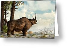 A Woolly Rhinoceros Trudges Greeting Card by Daniel Eskridge
