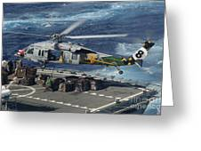 An Mh-60s Sea Hawk Helicopter Picks Greeting Card by Stocktrek Images