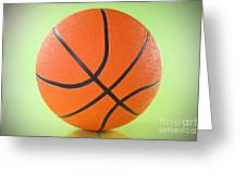 Basketball Ball Over A Green Background Greeting Card by G J