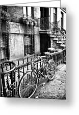 Bicycle In The Village Greeting Card by John Rizzuto