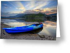 Blue Canoe At Sunset Greeting Card by Debra and Dave Vanderlaan
