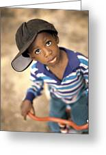 Boy Wearing Over Sized Hat Riding Bike Greeting Card by Ron Nickel