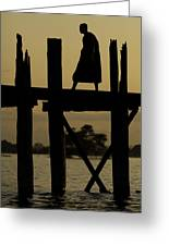 Buddhist Monk Walking Over U Bein's Bridge At Sunset Greeting Card by Ruben Vicente
