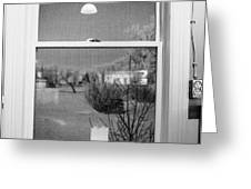 candle in the window looking out over snow covered scene in small rural village Greeting Card by Joe Fox