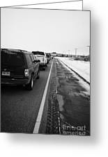 cars waiting on train crossing trans-canada highway in winter outside Yorkton Saskatchewan Canada Greeting Card by Joe Fox