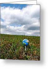 Earth Golf Ball On Tee Greeting Card by Amy Cicconi
