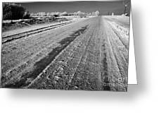 frozen salt and grit covered rural small road in Forget Saskatchewan Canada Greeting Card by Joe Fox