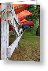 Kayaks On A Fence Greeting Card by Michael Mooney