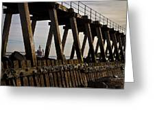 Lighthouse Through The Wooden Pier Greeting Card by Jim Jones